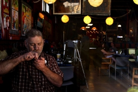 "by: L.E. BASKOW, Dennis ""Goofmystir"" Finnell smokes a marijuana pipe at the Cannabis Cafe in Northeast Portland, billed as the nation's first marijuana cafe. The private club, which recently closed and plans to move, supplies donated cannabis and is open only to medical marijuana cardholders."