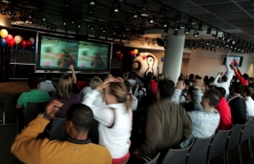 by: CHRISTOPHER ONSTOTT, Adidas employees react as Costa Rica plays Germany on the big screen at the Adidas headquarters during the 2006 World Cup. 204 nations are gearing up for the biggest sporting event in the world