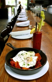 by: L.E. BASKOW, Tasty n Sons features many flavorful brunch dishes with a Spanish flair, including the patatas bravas with eggs over-easy and a Tasty Mary to wash it down.