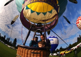 by: JAIME VALDEZ, Five-year-old Seth Sutton of Tigard takes a tethered ride from Lesley and Jesse Spencer in 2008 during the annual Festival of Balloons in Tigard, starting June 25.