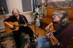 by: Jeffrey Basinger, Tom May plays folk with Grammy-award winning guitarist Doug Smith at the Medicine Whistle Studio. Tom May recently interviewed Doug Smith on his XM satellite radio show,