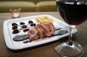 by: Jeffrey Basinger, Pitxi creates a new high-end, high-concept dining experience on North Lombard. The duck breast special features juicy cooked cherries and spicy dark chocolate, with a side of hand-shaped dumplings.
