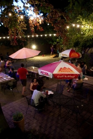 by: CHRISTOPHER ONSTOTT, The Landmark Saloon, a new bar on Southeast Division Street, has a large outdoor patio with smoking and non-smoking tables, beanbag horseshoes and ancient fruit trees in a huge side yard.