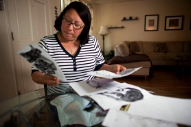 by: Christopher Onstott, Felesia Otis flips through drawings by her son Keaton in her North Portland home. Otis was trying to have her son Keaton civilly committed when he was shot and killed May 12 during a confrontation with Portland police.