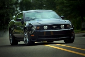by: CHRISTOPHER ONSTOTT, Old school looks and up-to-date performance features highlight the newest Ford Mustang.