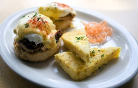 by: Jeffrey Basinger, A favorite at the City State Diner, a new restaurant in Northeast Portland that serves breakfast all day, is the smoked salmon steak Benedict with two poached eggs on biscuit.