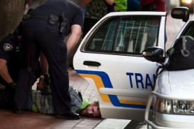 by: Christopher Onstott, A man is arrested by Portland transit police after an altercation outside Pioneer Courthouse, a zone heavily trafficked by panhandlers. Letter writers feel the aggressive behavior of some panhandlers damages the quality of life and business in downtown Portland.