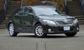 by: CHRISTOPHER ONSTOTT, Clean styling, spacious interior and comfortable ride mark the Camry, Toyota's entry in the mid-size affordable family car market.