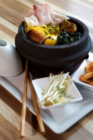 by: CHRISTOPHER ONSTOTT, Fin is a new seafood restaurant on Southeast Hawthorne with a Japanese flair. Dishes like the red snapper are served in a hot stone rice bowl with kimchi, pork cheek, black kale, wild mushrooms and egg yolk.