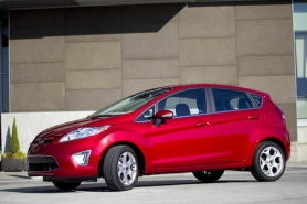 by: CHRISTOPHER ONSTOTT, The new Ford Fiesta has more to offer than good gas mileage, including contemporary styling, a long option list and surprisingly smooth ride for such a small car.