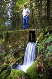 by: Christopher Onstott, Oxbow Fish Hatchery manager Dwayne Banks stands atop Oxbow Springs. Two My View writers weigh in on the pros and cons of Nestlé's proposal to extract 225 gallons of water per minute from the springs to use as bottled water.