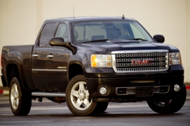 by: CHRISTOPHER ONSTOTT, Denali trim packages dresses up GMC's heavy duty Sierra workhorse.