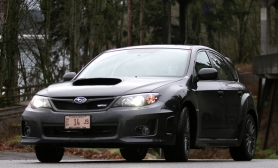 by: JAIME VALDEZ, The muscular look of the Impreza WRX is backed up by turbocharged performance and tenacious all-wheel-drive grip.