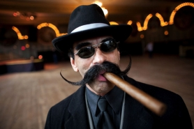 by: CHRISTOPHER ONSTOTT Steve Scarpa participated in the 2011 West Coast Beard and Mustache Championships at the Crystal Ballroom dressed as a mobster to accent his massive mustache.