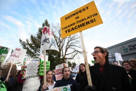 "by: Jaime Valdez Metzger Elementary teacher Brian Haliski chants ""bargain now, bargain fair"" with teachers from across the Tigard-Tualatin School District at a rally outside the district office on Tuesday."