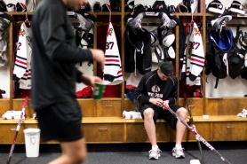 by: CHRISTOPHER ONSTOTT The Portland Winterhawks' Sven Bartschi, taping his stick prior to a game at Memorial Coliseum, has leaned on teammate and fellow Swiss native Nino Niederreiter in adjusting to life in the United States.