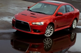 by: CHRISTOPHER ONSTOTT Punch the gas and by the time you've said Mitsubishi Lancer Ralliart,  