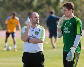 by: ROBERT MORA Timbers coach John Spencer (left) chats with goalkeeper Troy Perkins during practice.