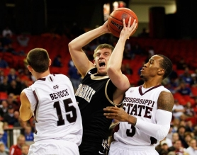 by: KEVIN C. COX Vanderbilt's starting point guard, Brad Tinsley from Oregon City, slashes through the Mississippi State defense in last weekend's SEC tournament.
