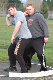 by: John Brewington PUTTING HARD—Scappoose's Tim Trask (left) and Chad Hollingsworth are two of the best shot putters in the league.