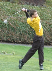 by: John Brewington TEEING OFF—St. Helens' Colin Chiddick takes a swing during the season's first match at Wildwood Monday.