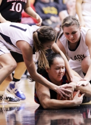 by: Chase Allgood Riley Gerlinger (left) and Morgan Birr of Banks battle for a loose ball against Madras.