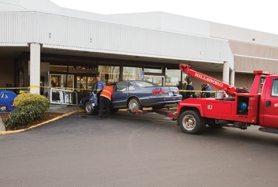 by: Chase Allgood A wayward car plowed through the eastern entrance of the Cornelius Fred Meyer store last Tuesday. No one was hurt in the accident, which was quickly boarded up. The timing of the accident was fortunate in two ways, with a customer moving out of the way of the car in the nick of time and the store slotted for future renovation.