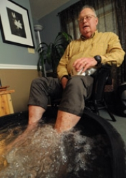 by: VERN UYETAKE Mike Bays, co-owner of Healthy Spaces in West Linn, relaxes with a foot bath and a cup of tea.