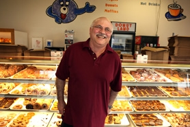 by: Jaime Valdez NUTS ABOUT DOUGH – George Wardini, owner of Doughnut Land in Tualatin, says that his top seller is the maple bar.