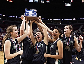 by: Miles Vance FIRST, FINALLY — Jesuit's (from left) Jackie Ritacco, Elizabeth Brenner, Claire Stach, Tasha Wilkins and Lauren Butz hoist the school's first-ever girls state basketball championship trophy on Saturday night.