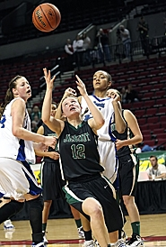 by: Miles Vance EYES ON PRIZE — Jesuit junior guard Jean Parker reaches for a rebound during her team's 57-35 quarterfinal win over South Medford at the Class 6A state basketball tournament on March 10.