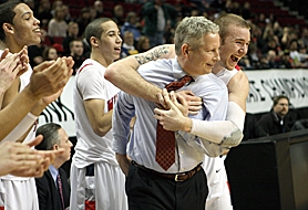by: Miles Vance WINNERS — Westview senior Austin Kuemper hugs coach Pat Coons while (left) Cole Gatewood and Miles Gatewood applaud their Friday win over North Medford.