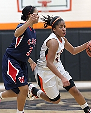 by: Miles Vance DRIVING FORCE — Beaverton senior guard Nicole Hartzog turns the corner against Westview in her team's Saturday playoff win.