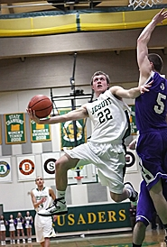 by: Miles Vance TO THE HOOP — Jesuit senior Ryan Benson goes in to score against Sunset on Saturday.