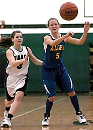 by: Dan Brood PASS IT — Aloha's Anna Moore passes during her team's playoff loss to Tigard.
