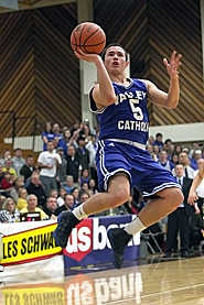 by: Miles Vance HANGING AROUND — Valley Catholic senior Cesar Catibayan hangs in the air to score during his team's quarterfinal loss to Horizon Christian on March 3.