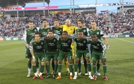 by: MICHAEL MARTIN The Portland Timbers' starting lineup poses before kickoff Saturday night in the club's inaugural MLS game at Colorado.