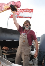 by: BART YOUNG A Colorado Rapids fan shows off his tailgate cooking before Saturday's game against the Portland Timbers.