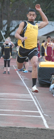 by: John Brewington FOUR WINS—St. Helens Dumitri Malnasi won the long jump, high jump, 100 meter dash, and anchored the 4x100 Relay win in last Thursday's meet.