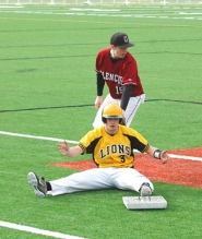 by: John Brewington OFF BASE—St. Helens' Tyler Stewart was called out while touching an out-of-place base Saturday.