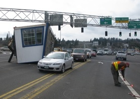 by: raymond rendleman Traffic inches by an overturned mobile home Tuesday afternoon in downtown Oregon City.