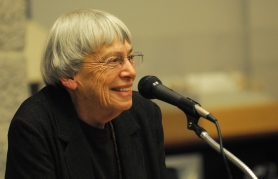 "by: Vern Uyetake Ursula K. Le Guin reads excerpts from her novel, ""The Wizard of Earthsea,"" Wednesday as part of the capstone event of the 2011 West Linn Reads program."