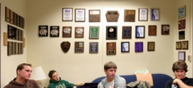 by: Jim Clark From left, Rob Sepich, Zach Nicholas, Dalton Hellman and Kimball Craig relax in the Mt. Hood Forensics Team room, the walls of which are festooned with plaques from the many competitions the group has won.