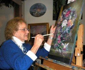 by: Jim Hart Anna Mae Lindsey puts the final touches on a painting of cut flowers in a vase. This image will be among other floral pieces also on display during April at the chamber. Art also from one of her students, Caren Topliff, also will hang in the chamber's visitor center.