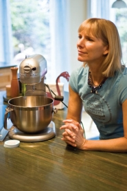by: Ed Johnson BAKING — Darcy McDonald sits in her kitchen by the tools of her trade, which is making cookies and other treats.