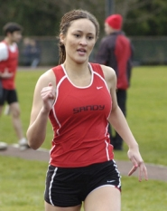by: Jeff Spiegel Sandy sprinter Juanita Birdsong won two individual races and played a part in a pair of relay wins.