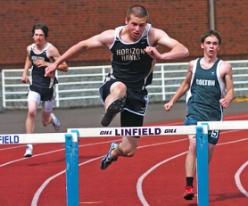 by: DAN BROOD DEFENDING CHAMP — Horizon Christian senior Tony Dubenko, shown here running in last year's West Valley League district meet, is the defending Class 3A state champion in the 110 high hurdles.