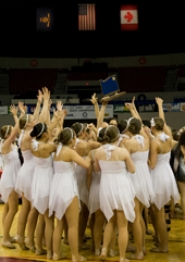 by: JAMES MCGREW The Lake Oswego High School dance team claims its championship trophy at state competition in Portland's Memorial Coliseum.