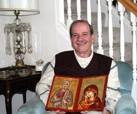 by: Polina Olsen Andreas Papachristopoulos of Tigard holds icons painted by his mother and sister. Both still live in Greece.