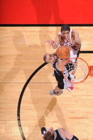 by: SAM FORENCICH Nicolas Batum puts up the winning shot over Tony Parker as the Trail Blazers stun the San Antonio Spurs at the Rose Garden.